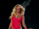 Pamela Anderson dust off the Famous Baywatch Swimsuit for Funkshion Fashion Week Miami