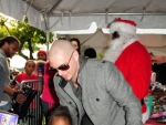 Photos:PitBull Play Santa during Toys Give-A-Way