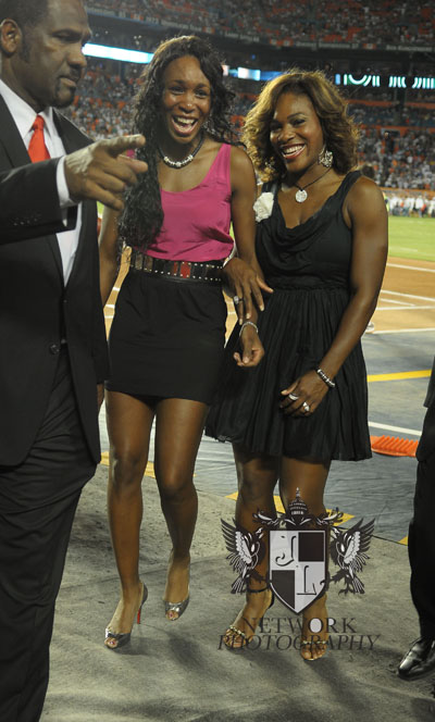 Venus Williams and  Serena Williams on the field during Monday night football season home game opener at Land Shark stadium photo by: Johnny Louis/ jlnphotography.com