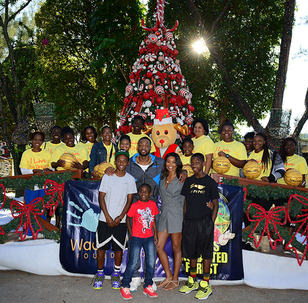 Dwyane Wade, wife Gabrielle Union and families At Santa's Enchanted Forest