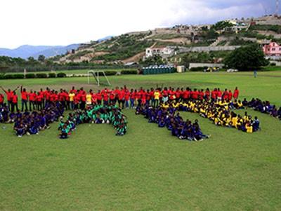 Team Fleur De Vie and the students | Photo by Johnny Louis/jlnphotography.com